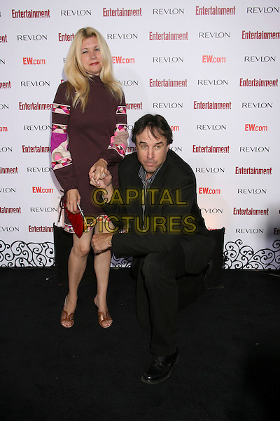 KEVIN NEALON & WIFE.Entertainment Weekly's 5th Annual Emmys Celebration held at the Opera - Crimson, Hollywood, California, USA..September 15th, 2007.full length black suit pink purple dress kneeling holding hands funny married husband .CAP/ADM/RE.©Russ Elliot/AdMedia/Capital Pictures.