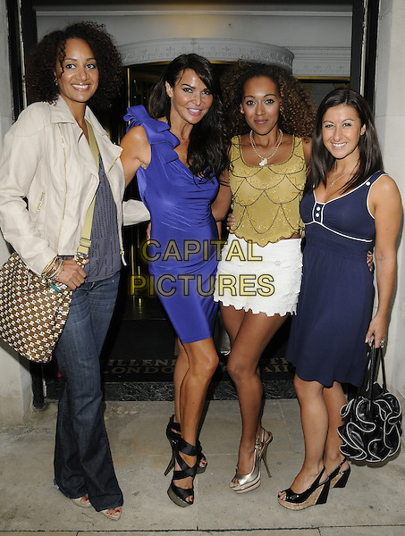 TUPELE DORGU, LIZZIE CUNDY, DANIELLE BROWN & HAYLEY TAMADDON.Beau Bronz VIP launch arrivals, Millenium hotel, Grosvenor Square, London, England..August 17th, 2011.full length grey gray purple blue white yellow dress top jacket shorts skirt brown bag purse jeans denim.CAP/CAN.©Can Nguyen/Capital Pictures.