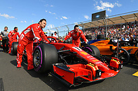 March 25, 2018: Mechanics wheel the car of Kimi Raikkonen (FIN) #7 from the Scuderia Ferrari team on the grid prior to the start of the 2018 Australian Formula One Grand Prix at Albert Park, Melbourne, Australia. Photo Sydney Low
