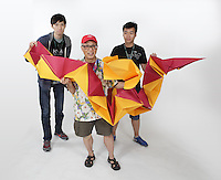 OrigamiUSA 2016 Convention at St. John's University, Queens, New York, USA. Oversized 9' x 9' paper folding event. First timers. Left to right: Winston Lee, NJ, Talo Kawasaki, NY, Ryan Dong, NY