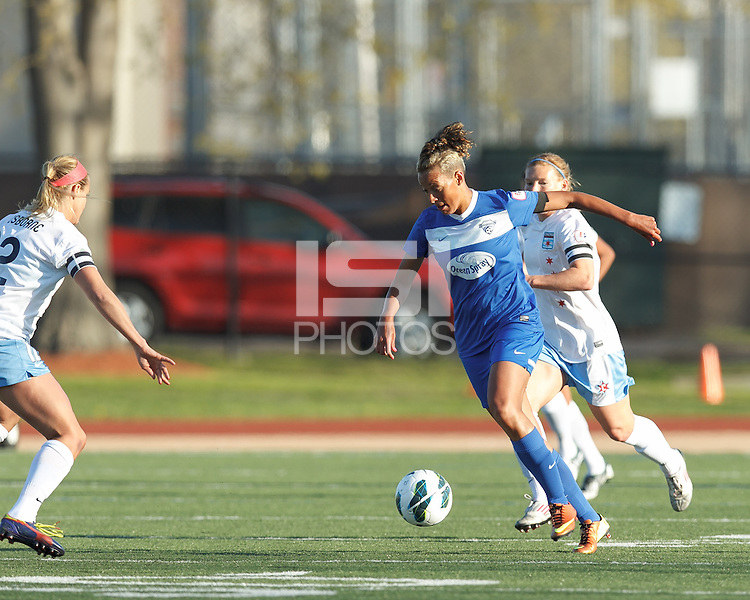 Boston Breakers forward Lianne Sanderson (10) brings the ball forward.  In a National Women's Soccer League Elite (NWSL) match, the Boston Breakers (blue) defeated Chicago Red Stars (white), 4-1, at Dilboy Stadium on May 4, 2013.