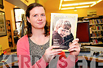 Librarian Niamh Doyle from the Dingle Library with the 1976 National Geographic Magazine featuring Dingle...