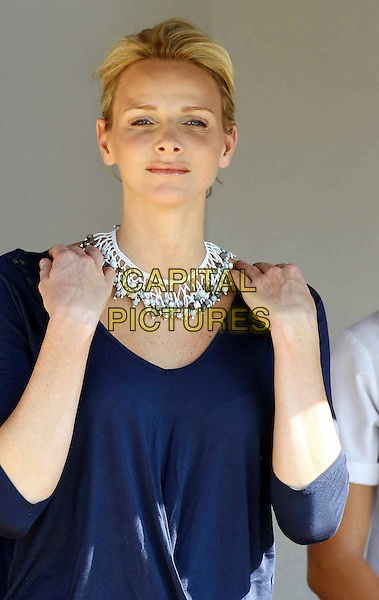 CHARLENE WITTSTOCK.The future Princess of Monaco attends a charity fundraising breakfast in support of the Special Olympics at St John's Diocesan School, Pietermaritzburg, South Africa. .February 11th, 2011.half length hands necklace silver blue top   on shoulders.CAP/PPG/WS.©Willi Schneider/People Picture/Capital Pictures