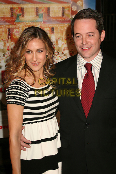 "SARAH JESSICA PARKER & MATTEW BRODERICK.Los Angeles Premiere of ""Deck The Halls"" at Grauman's Chinese Theatre, Hollywood, California, USA..November 12th, 2006.Ref: ADM/BP.half length dress black white striped stripes dress suit jacket husband wife married.www.capitalpictures.com.sales@capitalpictures.com.©Byron Purvis/AdMedia/Capital Pictures."