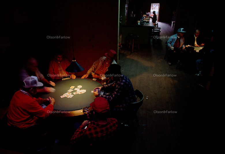 Retired dairy farmers gather around the poker table to play cards, a friendly ritual at the cafe in town.