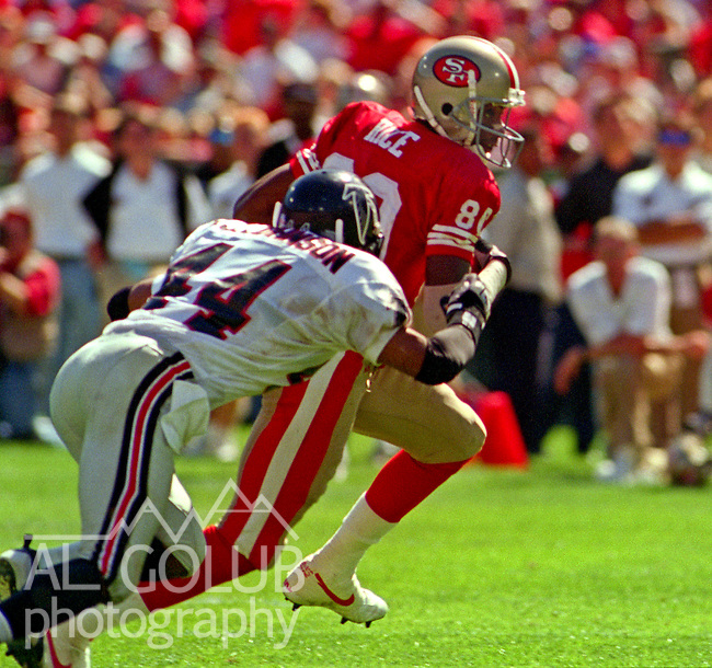 San Francisco 49ers vs. Atlanta Falcons at Candlestick Park Sunday, September 10, 1995.  49ers beat Falcons 41-10.  San Francisco 49ers wide receiver Jerry Rice (80) pulls away from Atlanta Flacons defensive back D.J. Johnson (44).
