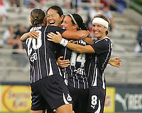 Homare Sawa #10 of the Washington Freedom with Abby Wambach #20,Sarah Huffman #14 and Sonia Bompastor #8 after she had scored the second goal during a WPS match against the Chicago Red Stars at the Maryland Soccerplex, in Boyds Maryland on June 12 2010. The game ended in a 2-2 tie.