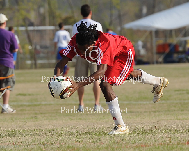 A member of the Chicago Fire Juniors - Louisiana U-18 team performs two forward flip throw ins during the Baton Rouge Soccer Association Red Stick Tournament.