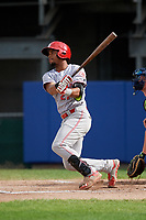 Greeneville Reds designated hitter Reniel Ozuna (27) hits an RBI single during the second game of a doubleheader against the Princeton Rays on July 25, 2018 at Hunnicutt Field in Princeton, West Virginia.  Greeneville defeated Princeton 8-7.  (Mike Janes/Four Seam Images)