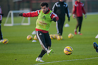 SWANSEA, WALES - JANUARY 28:  Jordi Amat of Swansea City kicks the ball forwards during training  on January 28, 2015 in Swansea, Wales.