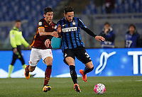 Calcio, Serie A: Roma vs Inter. Roma, stadio Olimpico, 19 marzo 2016.<br /> FC Inter's Danilo D'Ambrosio, right, is challenged by Roma's Diego Perotti during the Italian Serie A football match between Roma and FC Inter at Rome's Olympic stadium, 19 March 2016. The game ended 1-1.<br /> UPDATE IMAGES PRESS/Riccardo De Luca