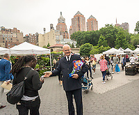 """Salvation Army Major Philip Wittenberg assists giving out free donuts in Union Square in New York during the celebration of  National Donut Day on Friday, June 3, 2016. Supported by Entenmann's, the bakers gave out tens of thousands of chocolate donuts and donated up to $35,000 to the Salvation Army. National Donut Day, the first Friday in June, was created in 1938 by the Salvation Army to honor the """"donut lassies"""" who administered treats and solace to soldiers during WW1. Entenmann's is a division of Bimbo Bakeries USA. (©  Richard B. Levine)"""