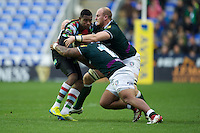 Ugo Monye of Harlequins is tackled by Halani Aulika and Matt Garvey (right) of London Irish during the Aviva Premiership match between London Irish and Harlequins at the Madejski Stadium on Sunday 28th October 2012 (Photo by Rob Munro)