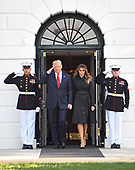 United States President Donald J. Trump salutes the Marine Guards as he and first lady Melania Trump walk out of the White House to lead a moment of silence in remembrance of those lost on September 11, 2001 on the South Lawn of the White House in Washington, DC on Monday, September 11, 2017.<br /> Credit: Ron Sachs / CNP