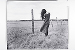 woman standing in field