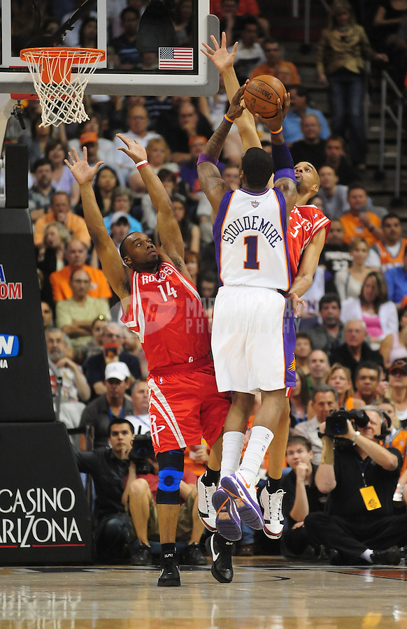 Mar. 22, 2008; Phoenix, AZ, USA; Phoenix Suns center Amare Stoudemire (1) shoots under pressure from Houston Rockets forward (14) Carl Landry and center (33) Loren Woods at the US Airways Center. Mandatory Credit: Mark J. Rebilas