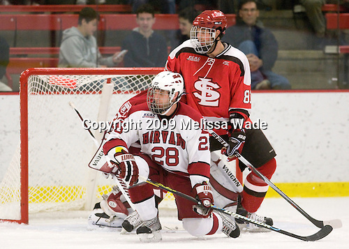 Chris Huxley (Harvard - 28), Brandon Bollig (St. Lawrence - 81) - The St. Lawrence University Saints defeated the Harvard University Crimson 3-2 on Friday, November 20, 2009, at the Bright Hockey Center in Cambridge, Massachusetts.