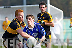 Kerins O'Rahillys is tackled by Johnny Buckley Dr Crokes in the Divison 1 league final in Killarney on Sunday