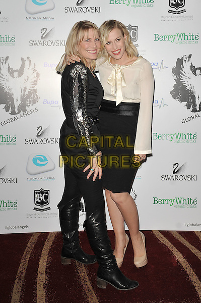 Holly and Natasha Bedingfield.'Global Angels Awards', The Park Plaza Hotel, Westminster, London, England. 2nd December 2011..full length white cream top bow long sleeve black skirt family sisters siblings .CAP/MAR.© Martin Harris/Capital Pictures.