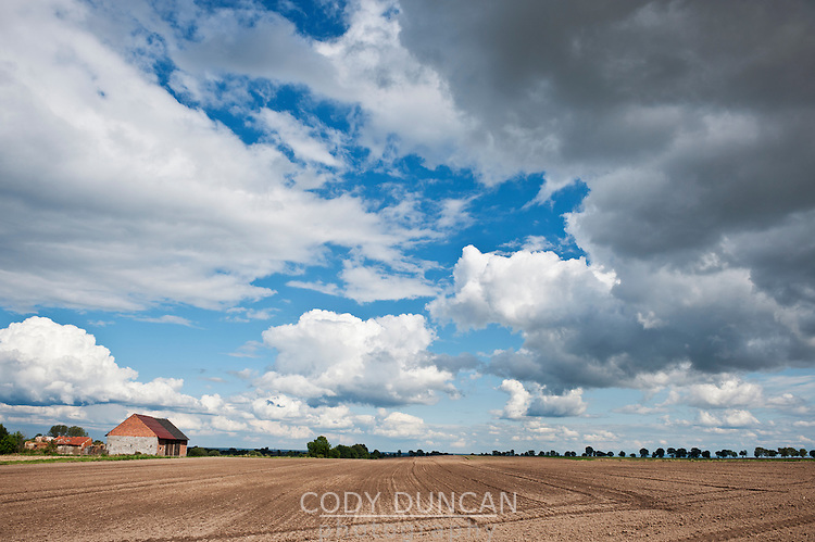 Newly plowed farm field in summer, Smicz, Prudnik, Southern Poland
