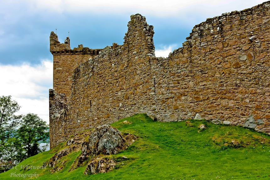 Looking at a wall at Urquhart Castle