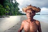 INDONESIA, Mentawai Islands, Kandui Resort, portrait of Mentawai man, Gesayas Ges, standing on the beach