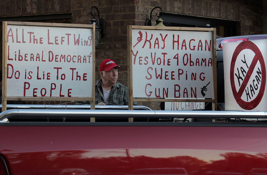 MOCKSVILLE, NC - NOVEMBER 2:  Jerry Easling stands near anti-Kay Hagan signs on his brother's truck in Mocksville, NC, on Sunday, November 2, 2014.  Easling was waiting to hear North Carolina Republican U.S. Senate candidate Thom Tillis speak at a campaign visit to Mocksville.  (Photo by Ted Richardson/For The Washington Post)