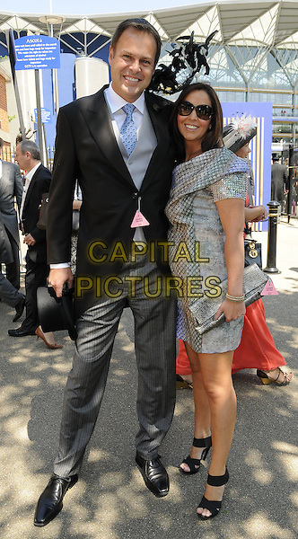 PETER JONES & TARA JONES.at Royal Ascot Ladies' Day, Ascot, Berkshire, England, UK,.June 17th 2010..full length married couple husband wife black blue tie jacket tailcoat grey gray trousers hat dress sunglasses sandals open toe clutch bag silver .CAP/CAN.©Can Nguyen/Capital Pictures.