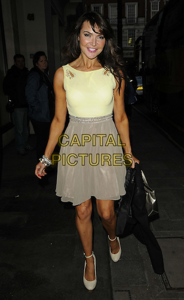 Lizzie Cundy.'The Cabin In The Woods' VIP screening, The May Fair Hotel, Stratton Street, London, England..5th April 2012.full length beige skirt yellow top.CAP/CAN.©Can Nguyen/Capital Pictures.