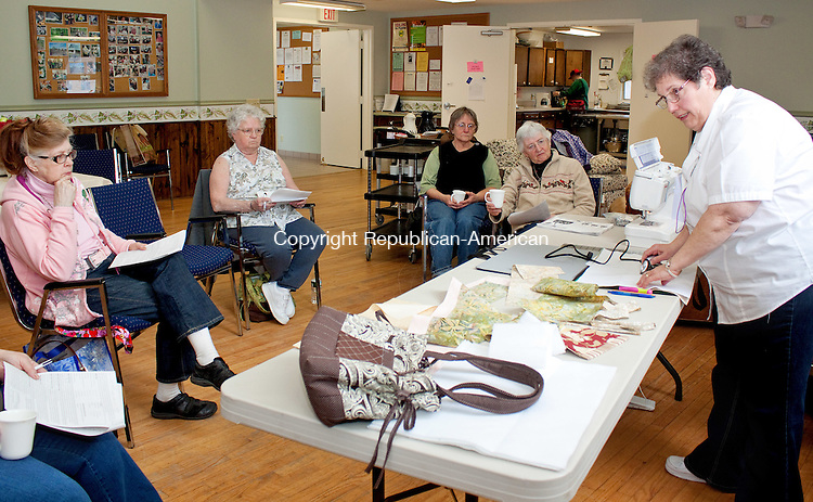 COLEBROOK CT-09 FEBRUARY 2011 021512DA01 - Member of the Colebrook Senior and Comminty Center, Charlotte Walenticonis of Pleasent Valley gives a demonstration on how to make a quilted tote to other members at the facility on Wednesday. The center welcomes the public to share their talents of crafting and quilting by bringing your items in for a show and tell and enjoy lunch together every Wednesday from 10:30am-2:00pm..DARLENE DOUTY REPUBLICAN AMERICAN