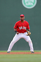 Third baseman Rafael Devers (13) of the Greenville Drive plays the infield in a game against the Augusta GreenJackets on Thursday, June 11, 2015, at Fluor Field at the West End in Greenville, South Carolina. Devers is the No. 6 prospect of the Boston Red Sox, according to Baseball America. Greenville won, 10-1. (Tom Priddy/Four Seam Images)