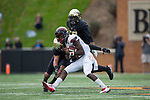 Louisville Cardinals quarterback Lamar Jackson (8) is tackled by Jessie Bates III (3) of the Wake Forest Demon Deacons during first half action at BB&T Field on October 28, 2017 in Winston-Salem, North Carolina.  The Demon Deacons defeated the Cardinals 42-32 (Brian Westerholt/Sports On Film)