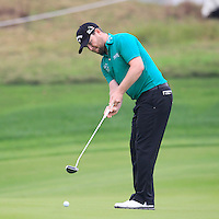 Branden Grace (RSA) putts on the 5th green during Saturay's Round 3 of the 2014 BMW Masters held at Lake Malaren, Shanghai, China. 1st November 2014.<br /> Picture: Eoin Clarke www.golffile.ie