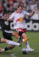 New York Red Bulls midfielder Chris Leitch (33) tries to keep possession of the ball while covered from behind by DC United midfielder Fred (7),DC United defeated The New York Red Bulls 4-1, at RFK Stadium in Washington DC, Saturday June 14, 2008.