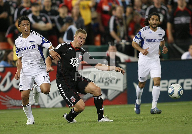 Daniel Allsopp #9 of D.C.United sends over a pass in front of Roger Espinoza #17 of the Kansas City Wizards during an MLS match at RFK Stadium on May 5 2010, in Washington DC. United won 2-1
