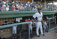 Manager Ivan De Jesus (11) of the Lexington Legends looks out over the field just prior to a game against the Greenville Drive on May 2, 2012, at Fluor Field at the West End in Greenville, South Carolina. Lexington won, 4-2. (Tom Priddy/Four Seam Images)