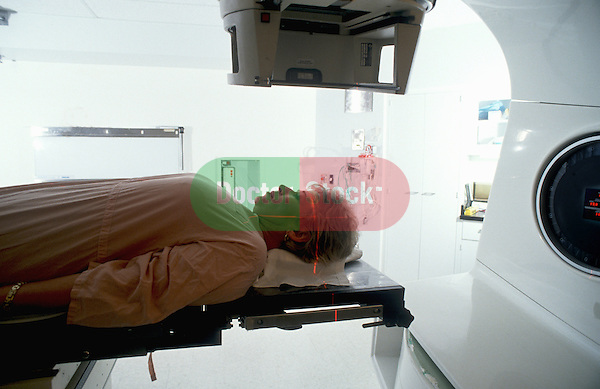 Woman receives radiation therapy