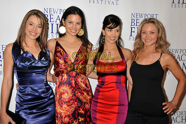 "SERAH D'LAINE, KATRINA LAW, AMIE BARSKY & JOLANE LENT.""Knuckle Draggers"" Premiere at the 2009 Newport Beach Film Festival held at Edwards Cinemas, Newport Beach, CA, USA..April 27th, 2009.half length dress red yellow orange paisley dress earrings gold sara sarah blue silk satin purple black.CAP/ADM/BP.©Byron Purvis/AdMedia/Capital Pictures."