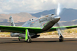 "A highly modified P-51D Mustang, owned by Ron Buccerelli and named ""Precious Metal,"" taxies along the ramp at Stead Field in Nevada following the 2007 Reno Air Races. Modified for racing the standard Rolls Royce Merlin motor has been replaced by a Rolls Royce Griffon motor that includes contra rotating propellers as well as a smaller canopy.  Photographed 09/07"