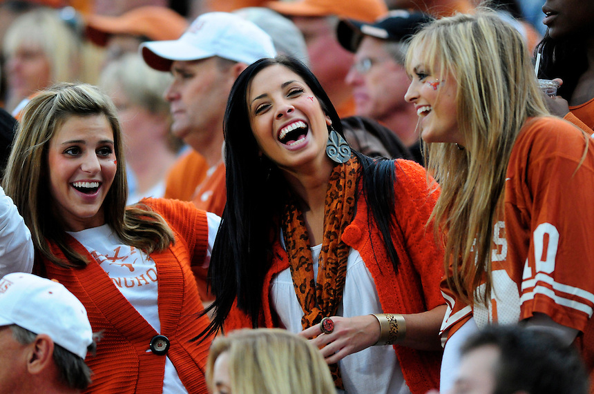 04 October 2008: A trio of female Texas fans laugh during a game against Colorado. The Texas Longhorns defeated the Colorado Buffaloes 38-14 at Folsom Field in Boulder, Colorado. For Editorial Use Only