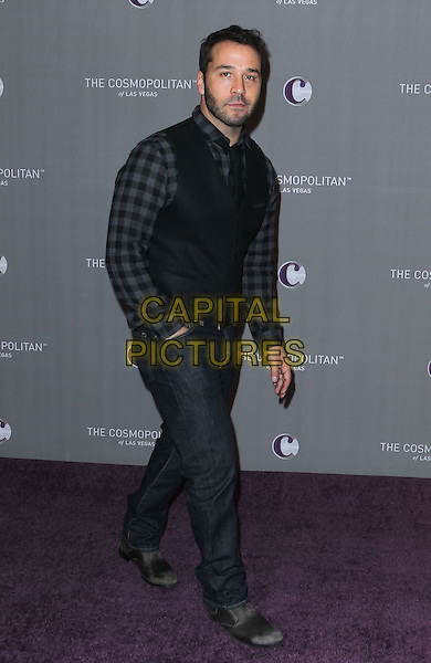 JEREMY PIVEN .New Year's Eve Grand Opening of the Cosmopolitan of Las Vegas, Las Vegas, Nevada, USA, 31st December 2010..full length black grey gray waistcoat checked check shirt gingham beard facial hair jeans hand in pocket .CAP/ADM/MJT.© MJT/AdMedia/Capital Pictures.
