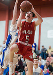 WOLCOTT, CT-031418JS03- Wamogo's Reid Turtoro (5) puts up a shot after getting  past an East Hampton defender during their Division V semifinal game Wednesday at Wolcott High School. <br /> Jim Shannon Republican-American