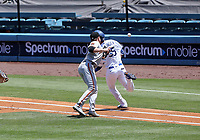 25th July 2020, Los Angeles, California, USA;  San Francisco Giants pitcher Logan Webb (62) attempts to tag out Los Angeles Dodgers outfielder Cody Bellinger (35) during the game against the San Francisco Giants on July 25, 2020, at Dodger Stadium in Los Angeles, CA.