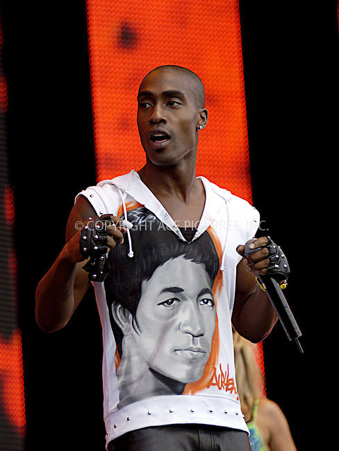 Blue - Simon Webbe at 95.8 Capital FM's Party in the Park 2004. Hyde Park, London, 11 July 2004.  ..FAMOUS.PICTURES AND FEATURES AGENCY.tel  +44 (0) 20 7731 9333.fax +44 (0) 20 7731 9330.e-mail info@famous.uk.com.www.famous.uk.com.FAM13212