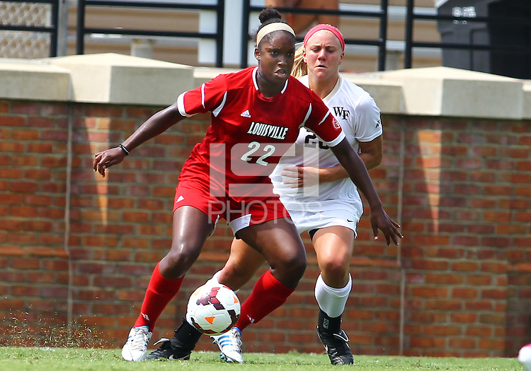WINSTON-SALEM, NORTH CAROLINA - September 01, 2013:<br />  Christine Exeter (22) of Louisville University moves away from Caralee Keppler (20) of Wake Forest University during a match at the Wake Forest Invitational tournament at Wake Forest University on September 01. The match was abandoned early in the second half due to severe weather with Wake leading 1-0.