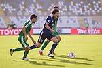 Tomiyasu Takehiro of Japan (C) fights for the ball with Batyrov Gurbangeldi (L) and Orazsahedov Vahyt of Turkmenistan (R) during the AFC Asian Cup UAE 2019 Group F match between Japan (JPN) and Turkmenistan (TKM) at Al Nahyan Stadium on 09 January 2019 in Abu Dhabi, United Arab Emirates. Photo by Marcio Rodrigo Machado / Power Sport Images
