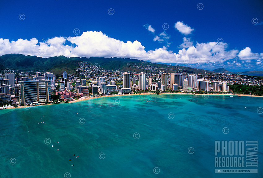 Aerial view of famous Waikiki beach with it's luxury hotels,warm water and white sand.