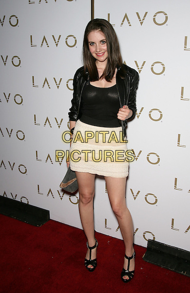 ALISON BRIE .at Lavo Inside the Palazzo Resort Hotel and Casino, Las Vegas, Nevada, USA, 30th April 2010..full length black leather jacket top white cream skirt peep toe t-bar shoes sandals .CAP/ADM/MJT.© MJT/AdMedia/Capital Pictures.