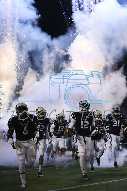 Nevada takes to the field before the first half of an NCAA college football game against Colorado State in Reno, Nev., on Saturday, Oct. 11, 2014. (AP Photo/Cathleen Allison)