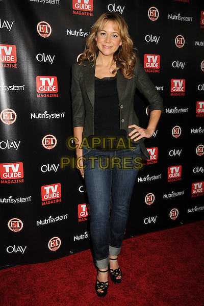 MEGYN PRICE.TV Guide Magazine's 2010 HOT LIST Party held at Drai's at the W Hotel, Hollywood, California, USA..November 8th, 2010.full length jacket top jeans denim hand on hip black lace green.CAP/ADM/BP.©Byron Purvis/AdMedia/Capital Pictures.